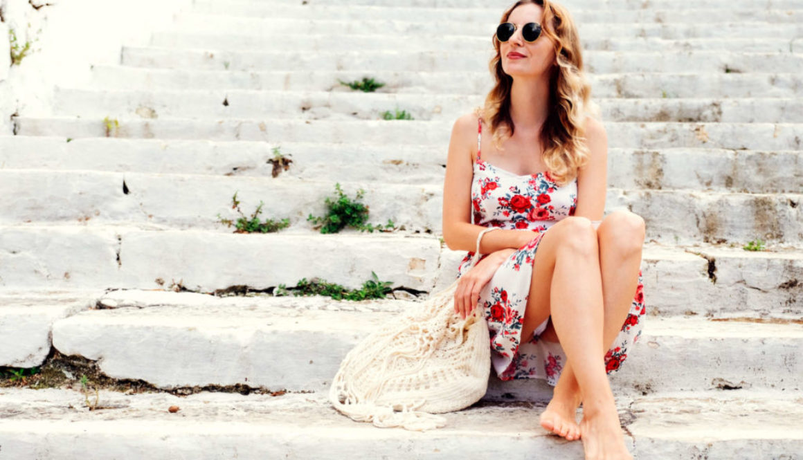 beauty-young-woman-in-dress-sitting-on-steps-PQE64E6-e1556583936659
